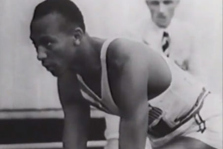Jesse Owens lines up at the start of the 100m final at the 1936 Olympics in Berlin