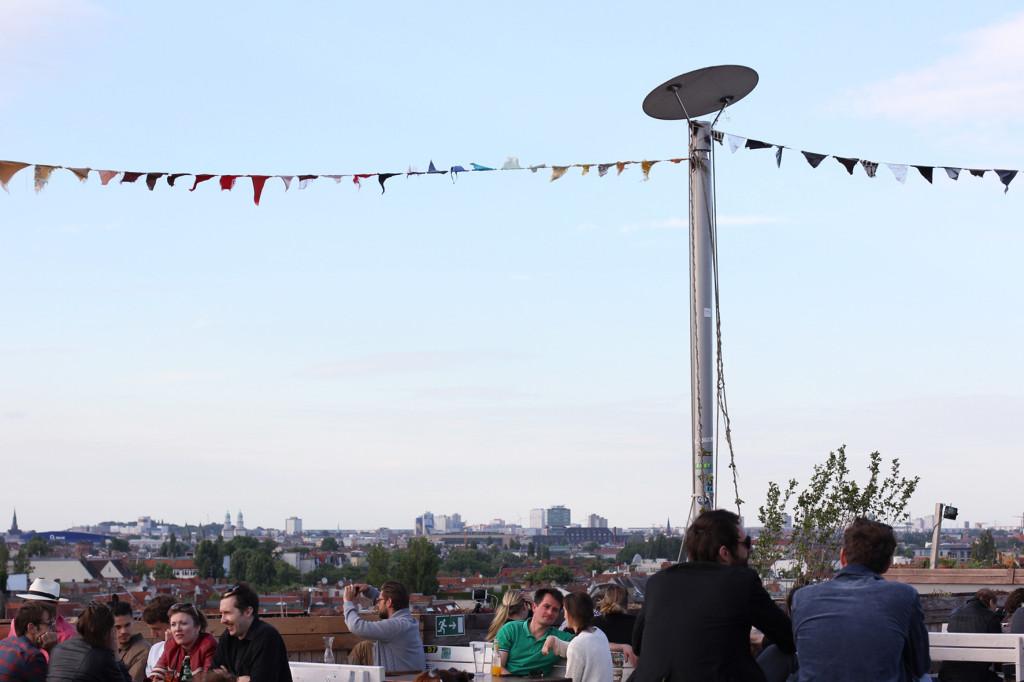 Drinkers and Skyline at Klunkerkranich Berlin, a bar on the rooftop of the Neukölln Arcaden Shopping Centre