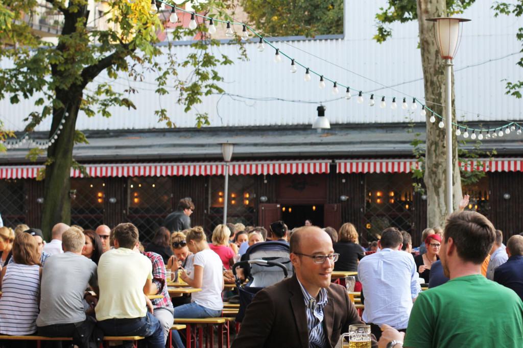 Drinkers at PraterGarten Beer Garden in Berlin