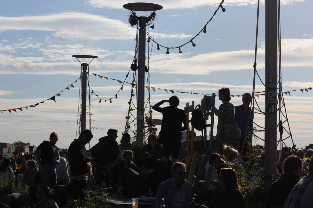 The Crowd in Silhouette at Klunkerkranich Berlin, a bar on the rooftop of the Neukölln Arcaden Shopping Centre