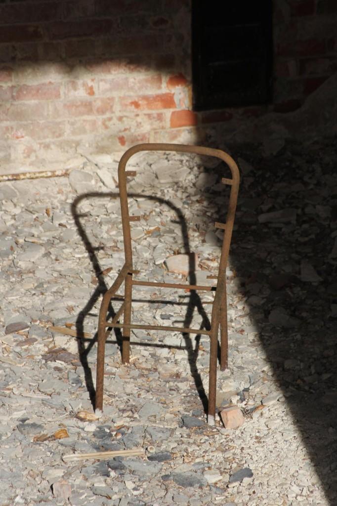 A lone chair in the ruins of the Alpenhaus seen from the Treetop Walkway of the Baumkronenpfad Beelitz-Heilstätten near Berlin