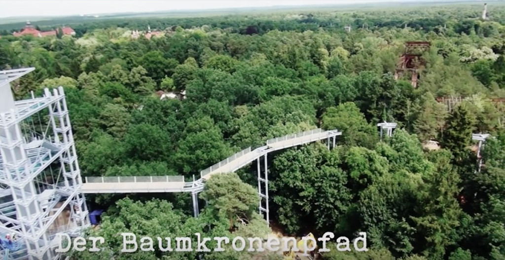 Screenshot from Making of Baumkronenpfad Beelitz-Heilstätten by Thomas Kaser showing the treetop walkway at the abandoned lung clinic and sanatorium under construction