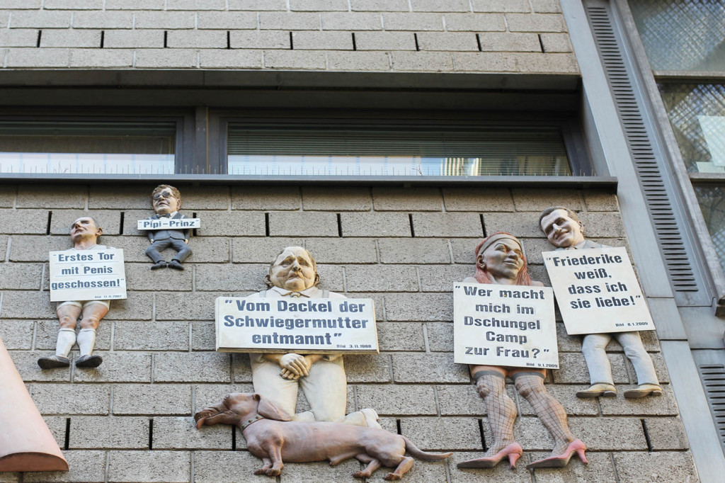 Some of the characters featured on the Giant Penis Relief (a Kai Diekmann caricature) - Friede sei mit Dir (Peace Be With You) or Der Pimmel über Berlin (The Cock Over Berlin) by Peter Lenk on the offices of Die Tageszeitung (taz) on Rudi-Dutschke-Strasse in Berlin