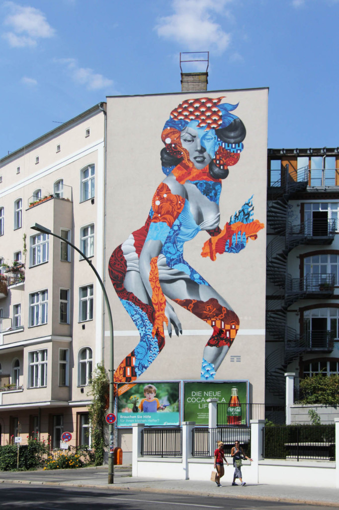 Attack of the 50 Foot Socialite a street art mural by Tristan Eaton on a building at Am Friedrichshain 33 in Berlin towers over passersby