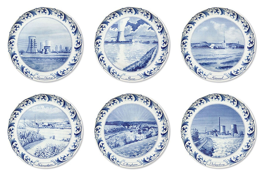 A selection of designs from Atomteller, a range of porcelain wall plates with blue and white designs of German nuclear power plants in idyllic landscapes
