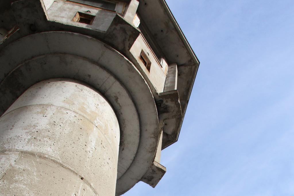 The observation deck and round shaft of the BT-6 Berlin Wall Watchtower on Erna-Berger-Strasse near Potsdamer Platz seen from below