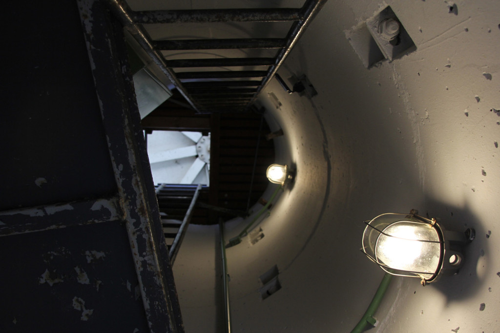 Looking up the round shaft and two ladders of the BT-6 Berlin Wall Watchtower on Erna-Berger-Strasse near Potsdamer Platz