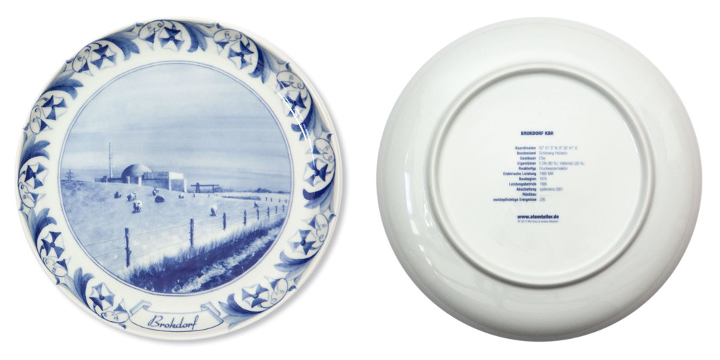 The front and back of the Brokdorf KBR plate from Atomteller, a range of porcelain wall plates with blue and white designs of German nuclear power plants in idyllic landscapes
