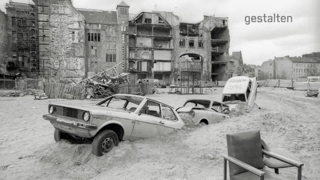 Cars Outside half buried in the ground outside a derelict Tacheles - Photo by Ben de Biel - Still from Berlin Wonderland: Pictures from a Forgotten City by Gestalten.tv