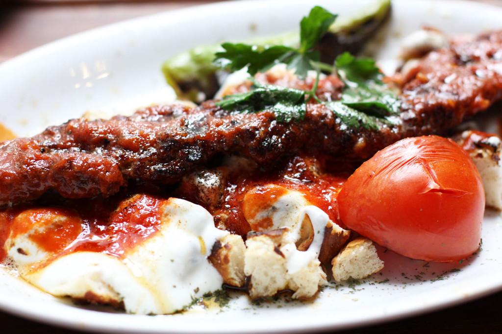 Close up of the Adana Kebap Yoğurtlu at Doyum Grillhaus, a Turkish restaurant on Admiralstraße near Kottbusser Tor in Berlin Kreuzberg