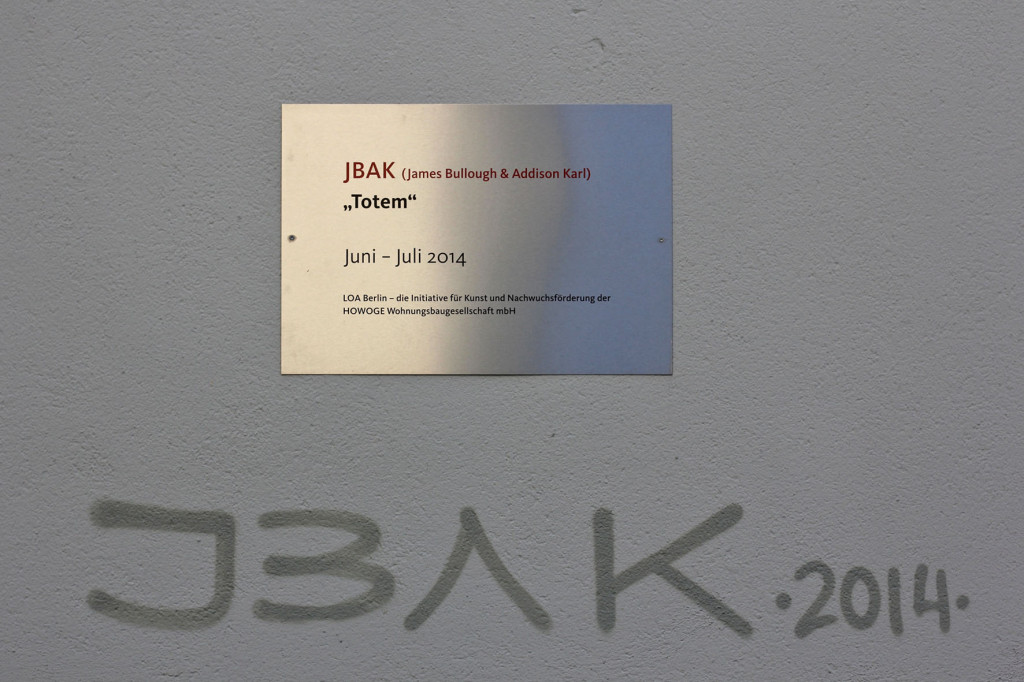 Plaque and signature for the JBAK Totem Mural on the side of the HOWOGE building at Landsberger Allee 228B in Lichtenberg in Berlin