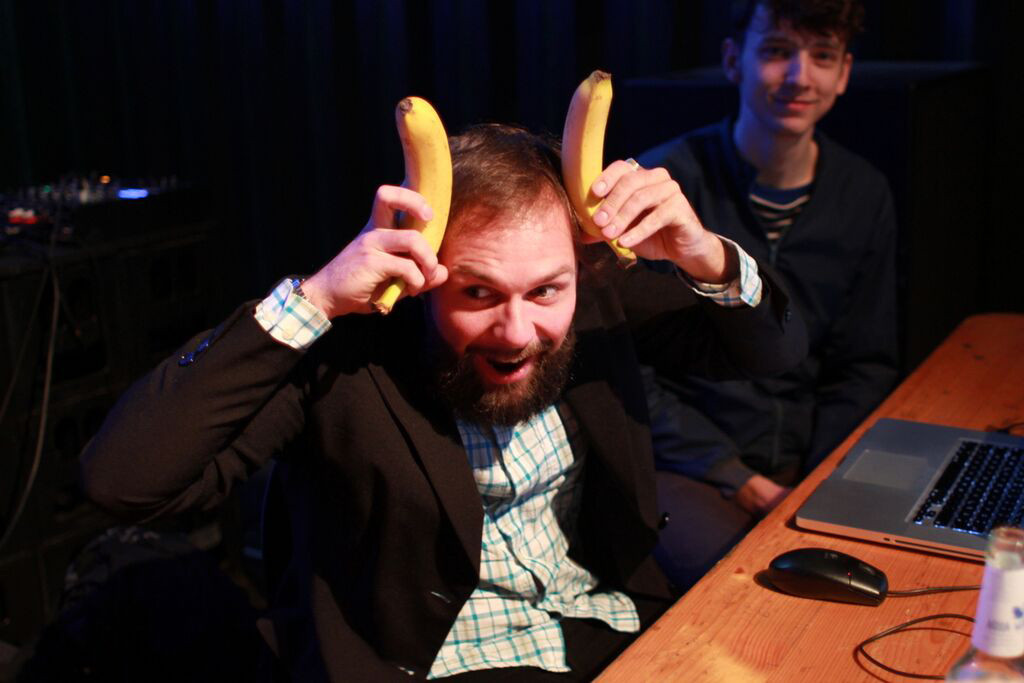 A hacker at uses bananas as horns at Photo Hack Day 3 in Berlin organised by Berlin-based photo sharing app EyeEm
