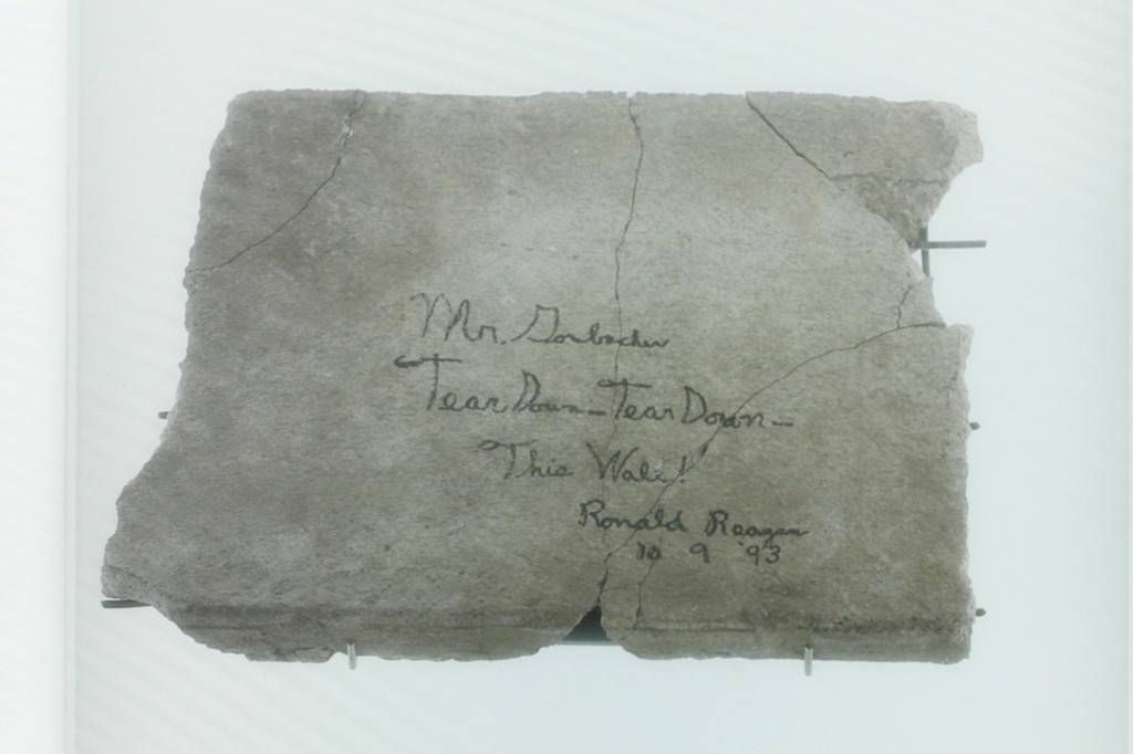 The Reagan Berlin Wall - a piece of the Berlin wall with a quote from Reagan's 'Tear Down This Wall speech' and signed by the former US President - at Dussmann Kulturkaufhaus bookshop on Friedrichstraße in Berlin