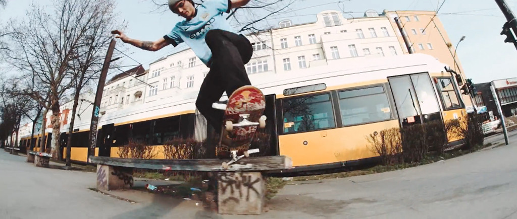 Skateboarding at the Warschauer Straße benches as a tram passes in the background - Still from Modest Meets - Denny Pham