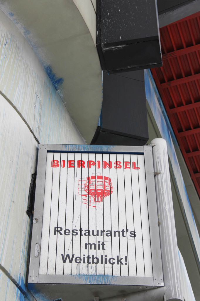 A sign on the Bierpinsel, a brutalist tower in Berlin Stieglitz, advertising restaurants with a view