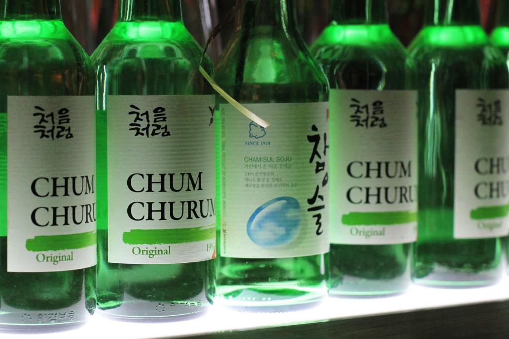 Green bottles decoration on the bar at WaWa Berlin Korean Restaurant