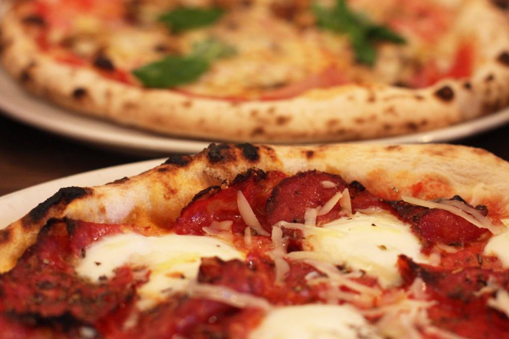 Spianata (tomatoes, mozzarella, spicy salami, oregano, Grana Padano and olive oil) and Ham, mushrooms, basil pizzas at Zola Berlin Pizzeria in a Hinterhof (courtyard) on Paul-Lincke-Ufer in Kreuzberg