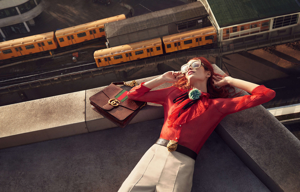 Model lying on a roof overlooking a Berlin U-Bahn station - from the Gucci Spring Summer 2016 ad campaign by Glen Luchford for Allessandro Michele
