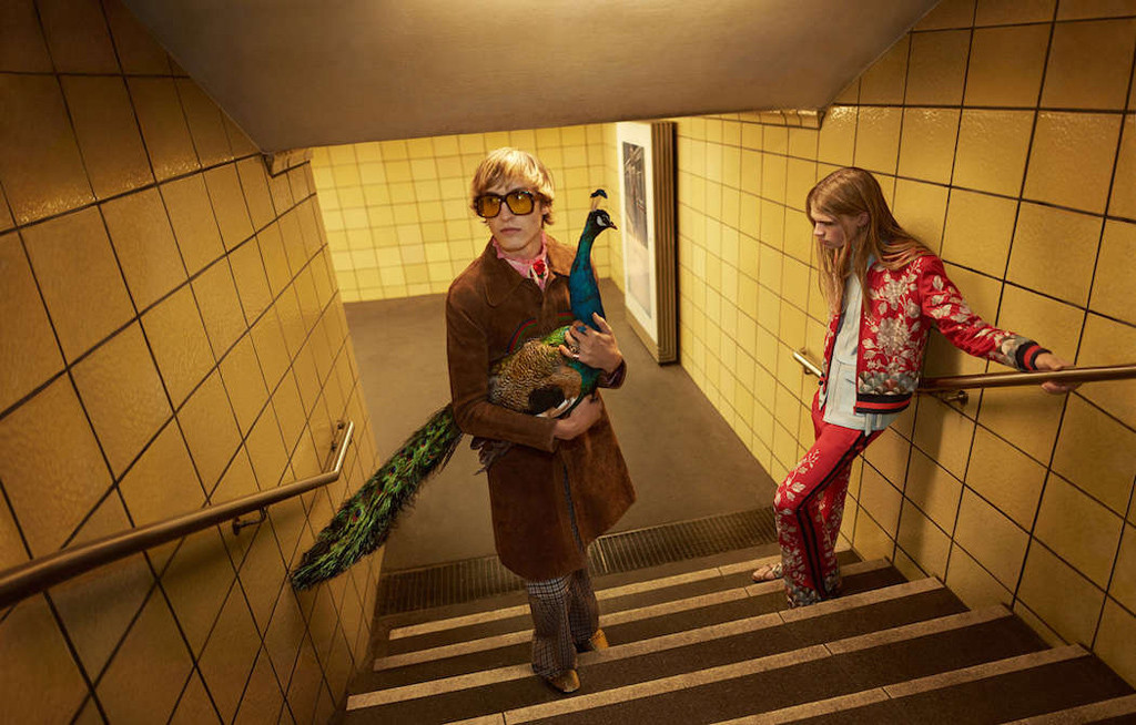 A man holding a peacock in a Berlin U-Bahn station - from the Gucci Spring Summer 2016 ad campaign by Glen Luchford for Allessandro Michele
