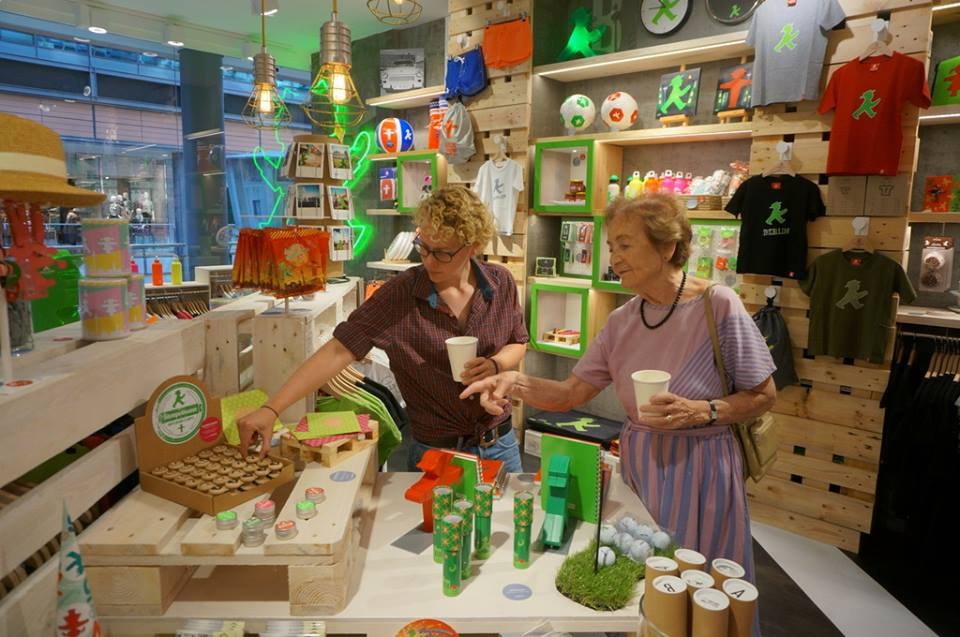 Customers browse the wide range of Ampelmann themed products at the Ampelmann shop in Berlin Potsdamer Platz