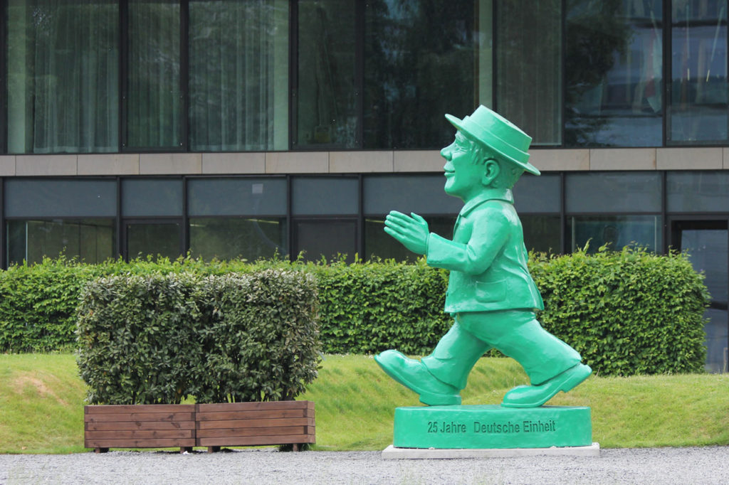 The giant Ampelmann statue by Ottmar Hörl for the 25th anniversary of German reunification outside the Hessische Landesvetretung in Berlin seen striding