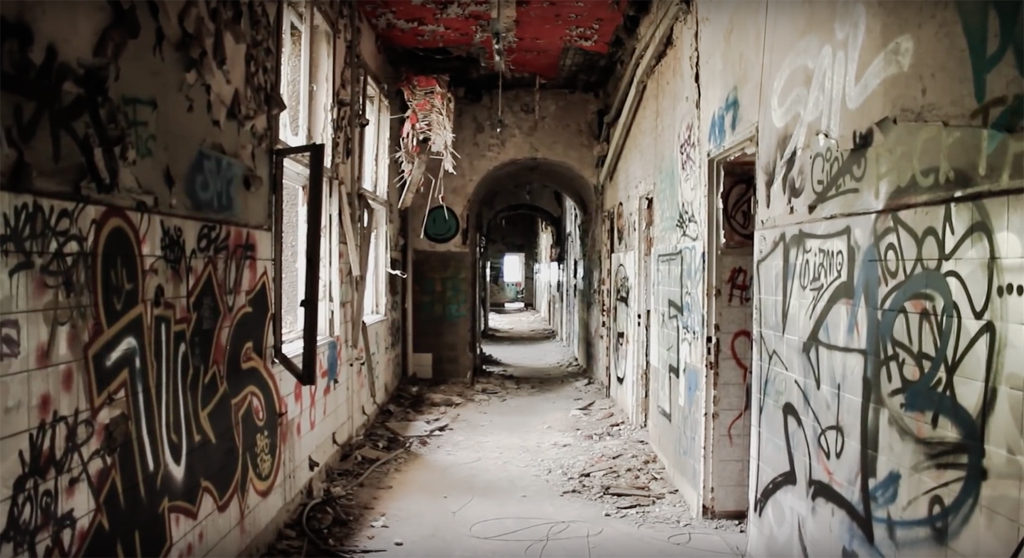 A corridor in a derelict building - screen Shot from Abandoned Berlin Documentary by Jordi Busquets