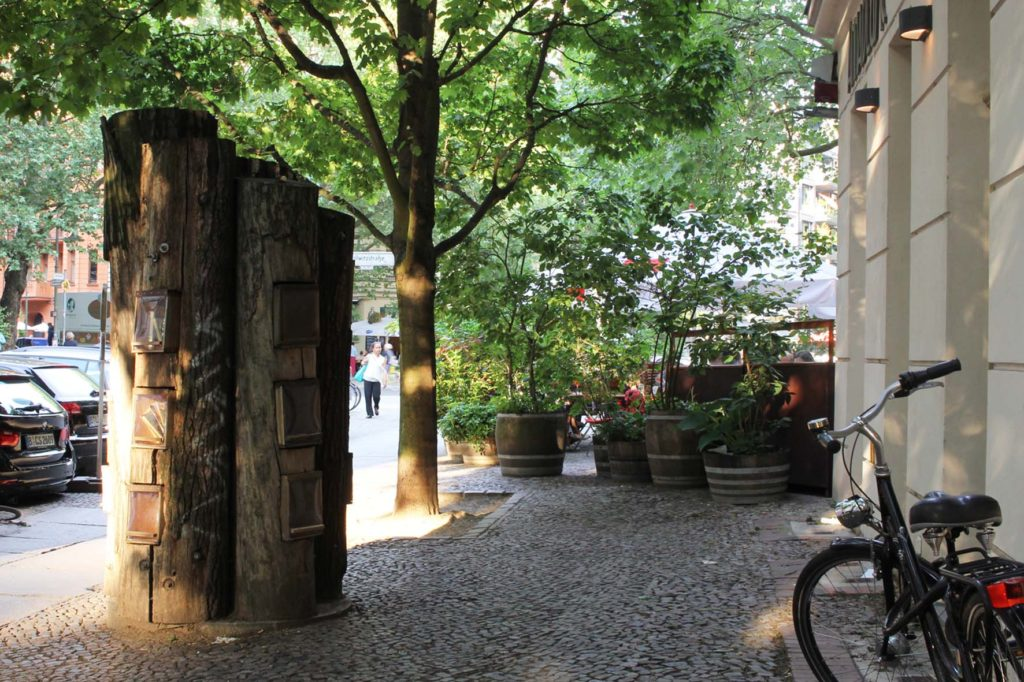 Bücherwald (book forest) - a lending library with shelves carved into logs bolted together to resemble a tree on Sredzkistrasse in Berlin Prenzlauer Berg