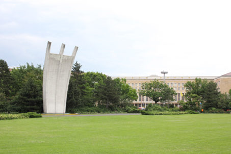 Berlin Airlift Memorial (Luftbrückedenkmal) on Platz der Luftbrücke, referred to by Berliners as the Hungerharke (Hunger Rake) or Hungerkralle (Hunger Claw) and in the background Tempelhof Airport