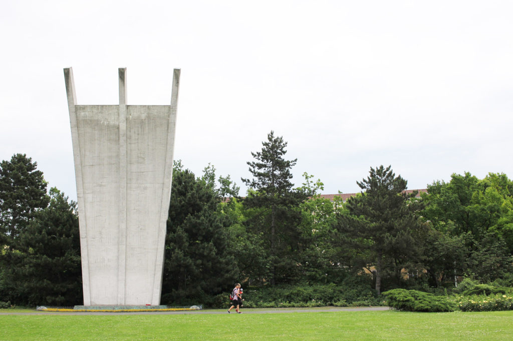 Berlin Airlift Memorial (Luftbrückedenkmal) on Platz der Luftbrücke, referred to by Berliners as the Hungerharke (Hunger Rake) or Hungerkralle (Hunger Claw) with people walking past for scale