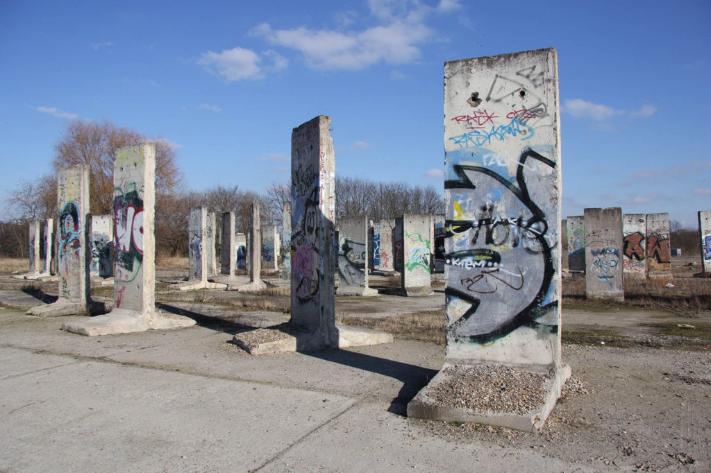 Berlin Wall Graveyard - Graffitied sections of the Berlin wall on waste ground in Teltow that will soon be part of the Teltow Marina - Photo February 2014