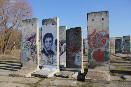 Berlin Wall Graveyard - Painted sections of the Berlin wall on waste ground in Teltow that will soon be part of the Teltow Marina - Photo February 2014