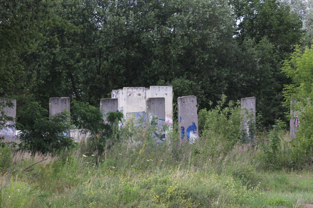 Berlin Wall Graveyard - Sections of the Berlin wall on waste ground in Teltow that will soon be part of the Teltow Marina - Photo June 2016