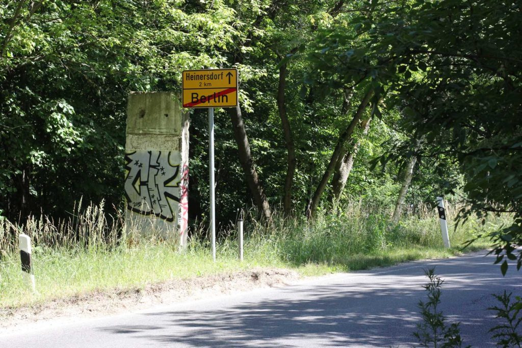 The Berlin Brandenburg border and a section of the Berlin wall on Osdorfer Strasse at the edge of Parks Range Doughboy City - a former military training ground of the US Army Berlin Brigade