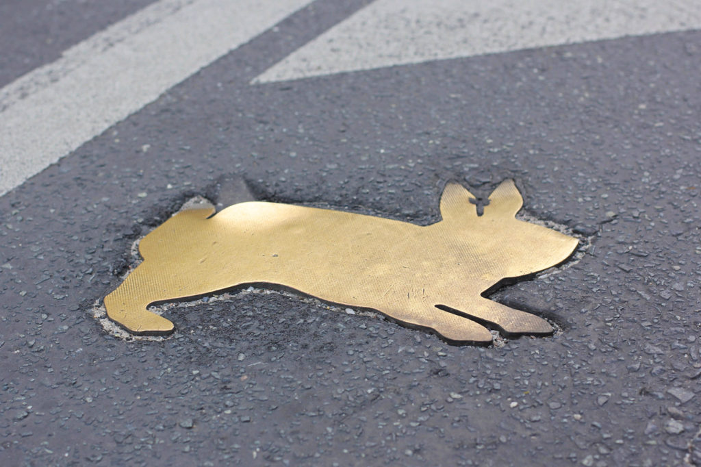 One of the brass rabbits of the Kaninchenfeld (Rabbit Field), a memorial to the rabbits that lived on the Berlin Wall death strip by Karla Sachse at the site of a former border crossing point on the Chausseestrasse in Berlin