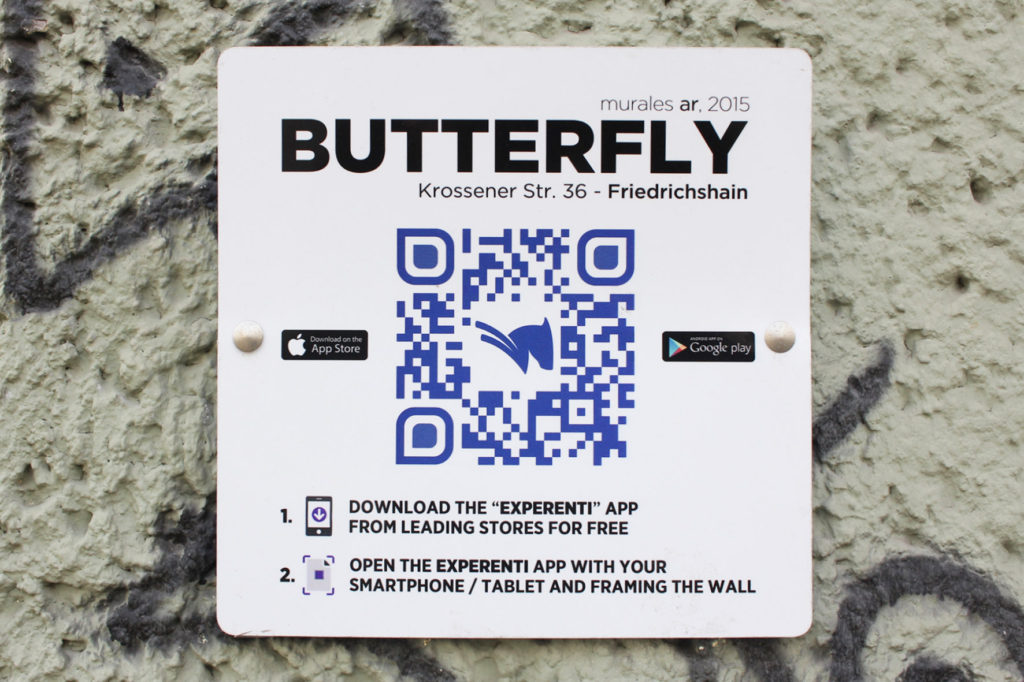 Butterfly Mural - Street Art by Michelle Tombolini in Berlin - Plaque at Korossener Strasse 36 giving details of the Augmented Reality app