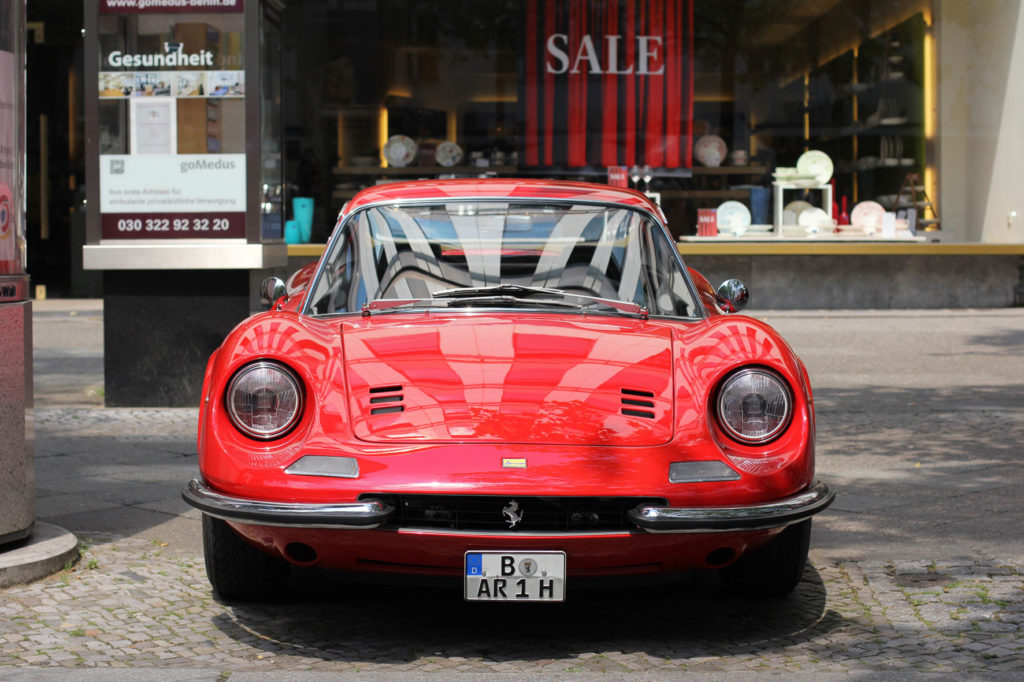 A red Ferrari Dino 246 at Classic Days Berlin - an annual classic car event held on the Kurfürstendam