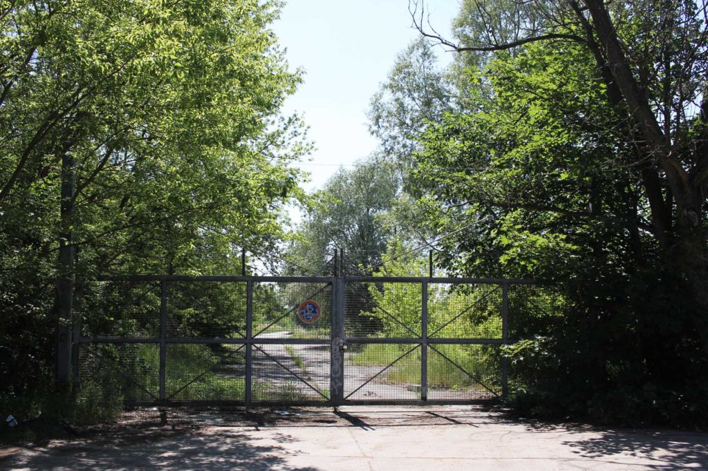 The entrance gate for wheeled vehicles on Osdorfer Strasse at Parks Range Doughboy City - a former military training ground of the US Army Berlin Brigade