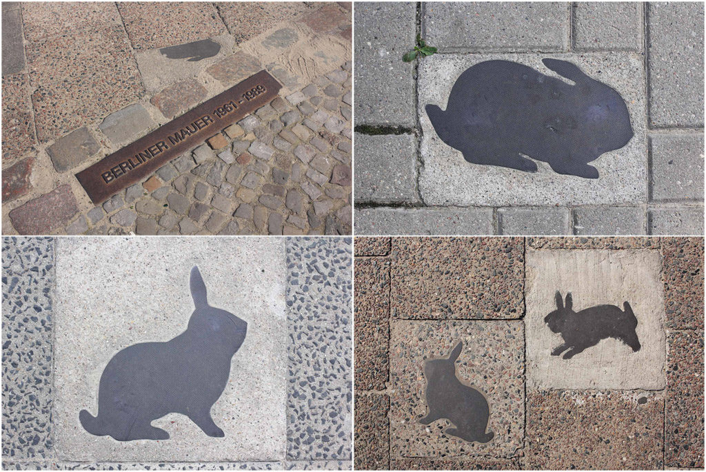 A collection of the brass rabbits on the pavement of the Kaninchenfeld (Rabbit Field), a memorial to the rabbits that lived on the Berlin Wall death strip by Karla Sachse at the site of a former border crossing point on the Chausseestrasse in Berlin
