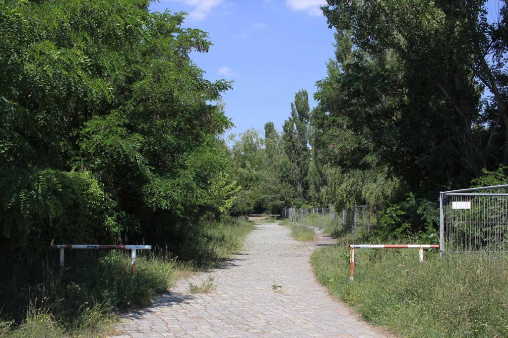 Path parallel to the S-Bahn tracks at the perimeter of Parks Range Doughboy City - a former military training ground of the US Army Berlin Brigade