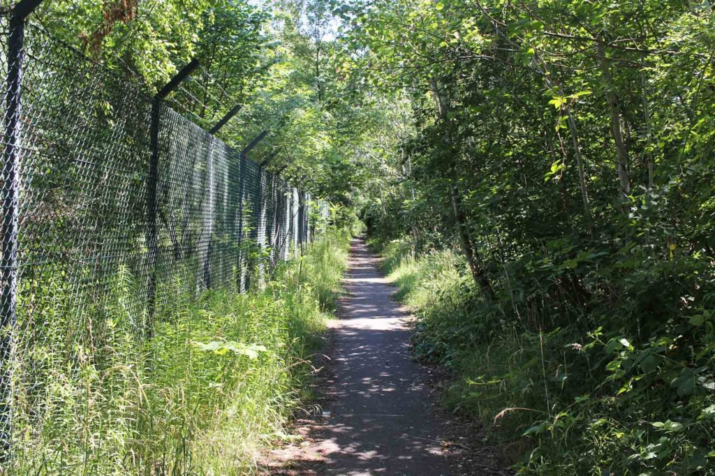 Path and perimeter fence parallel to the former line of the Berlin wall at Parks Range Doughboy City - a former military training ground of the US Army Berlin Brigade