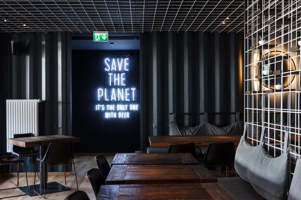 SAVE THE PLANET - IT'S THE ONLY ONE WITH BEER neon artwork at BRLO Brwhouse - a craft beer brewery, bar, restaurant and beer garden and the edge of Park am Gleisdreieck in Berlin