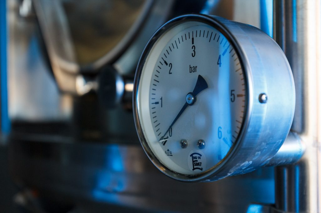 Pressure gauge on a tank in the brewery at BRLO Brwhouse - a craft beer brewery, bar, restaurant and beer garden and the edge of Park am Gleisdreieck in Berlin