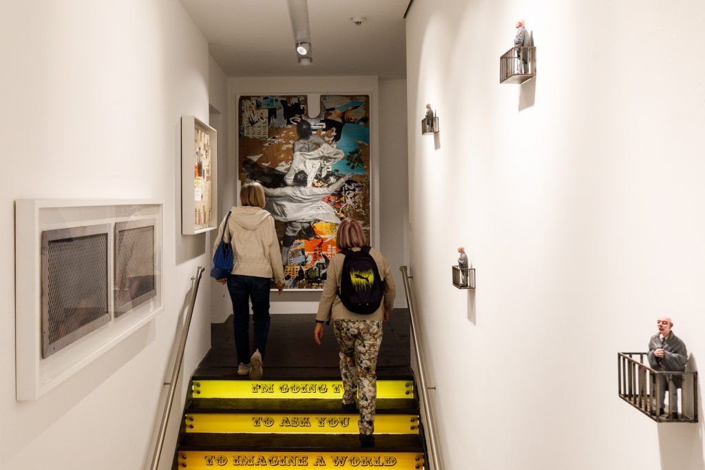 Visitors climb the Ben Eine stairs at Urban Nation Museum for Urban Contemporary Art in Berlin