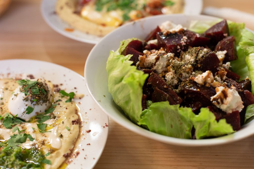 Beetroot Salad, Masabacha and Hummshuka at Kanaan in Berlin, a modern Middle Eastern restaurant run by an Israeli and a Palestinian