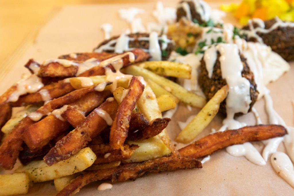 Fries and Sweet Potato Fries on the Falafel Teller at Kanaan in Berlin, a modern Middle Eastern restaurant run by an Israeli and a Palestinian