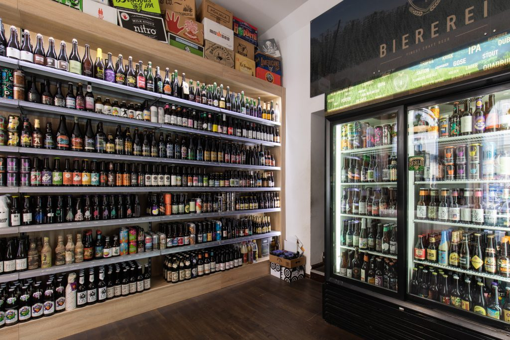 Shelves and beer fridges at Biererei Store Berlin - a craft beer bottle shop in Kreuzberg
