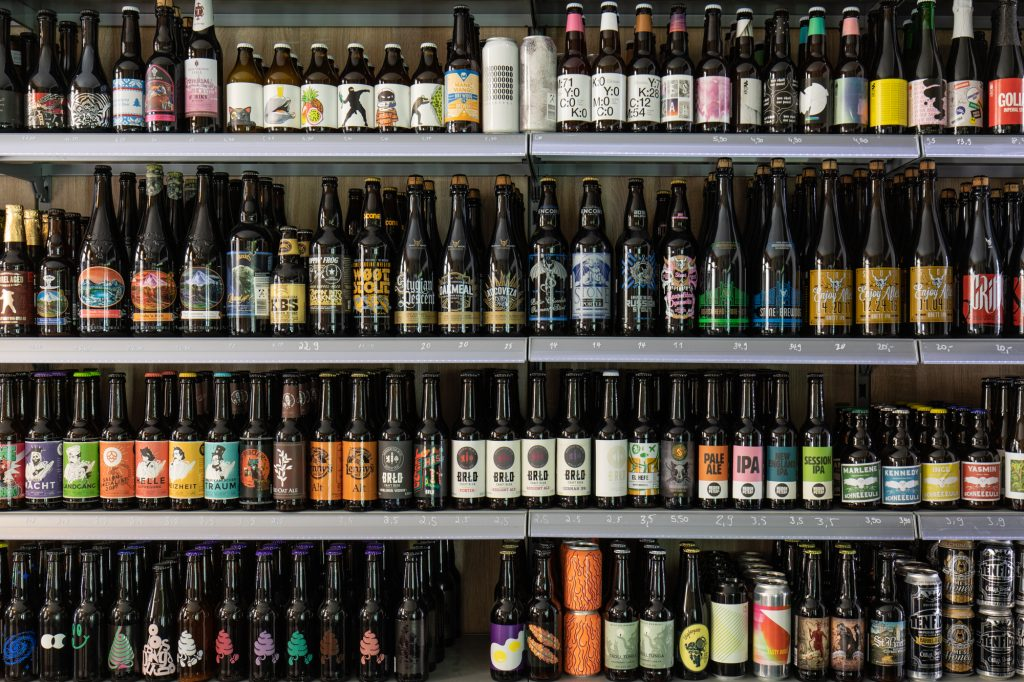 Shelves full of beer at Biererei Store Berlin - a craft beer bottle shop in Kreuzberg