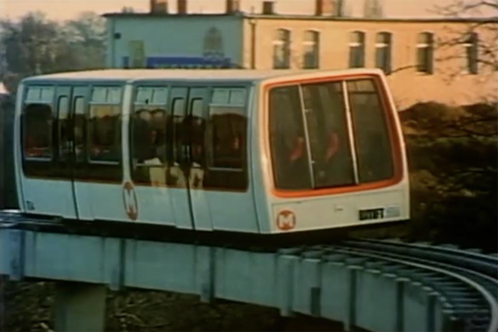 M-Bahn Berlin - a short-lived monorail or Maglev (magnetic levitation) train that travelled along an approximately 1.6km stretch from the lower tracks of the U-Bahn station Gleisdreieck (now the U2) to Kemperplatz via the station at Bernburger Strasse (approximately where the U2 station Medelssohn-Bartholdy-Park is today) - Screenshot from the YouTube video Die M-Bahn in Berlin | Industriefilm aus 1985