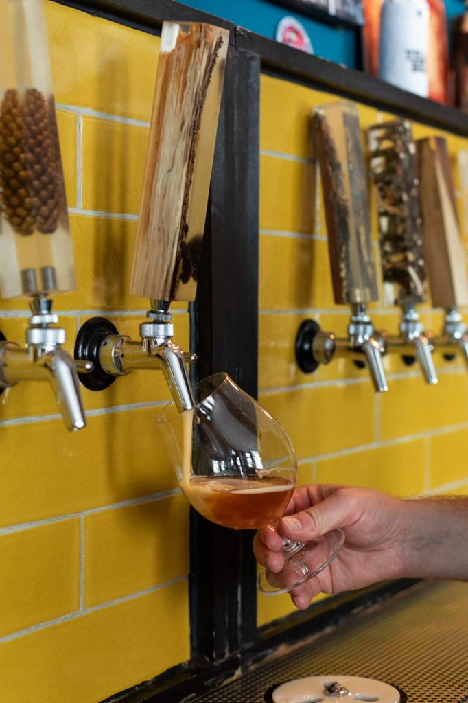 A beer being poured at Protokoll Taproom Berlin, a craft beer bar with 24 taps in Berlin Friedrichshain
